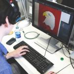 Graphics designer working on computer